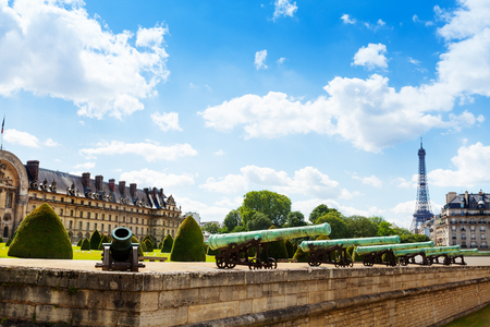 Invalides canons and Eifel tower on background