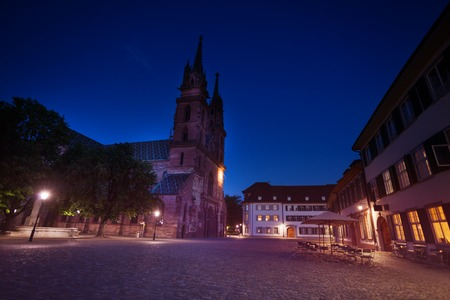 Towers of Basel Minster cathedral against dark sky