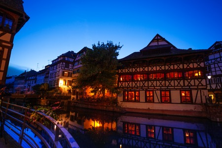 Houses along Ill river bank at sunset, Strasbourg Stock Photo