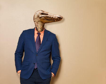 Male lizard in office clothing suit and shirt Фото со стока
