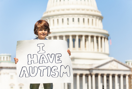 Protester holding sign I have autism in hands Imagens - 119380147