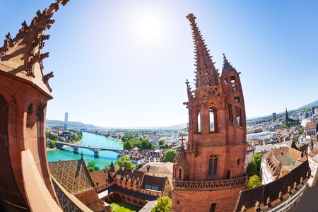 Basel cityscape and Minster tower against blue sky Stock Photo