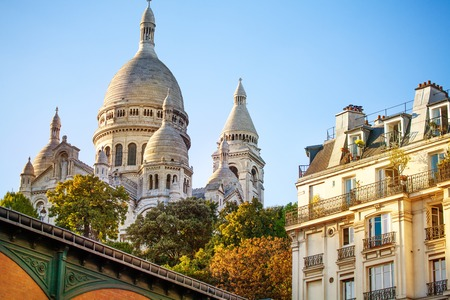 Sacre Coeur cathedral over classical Paris house Stock Photo