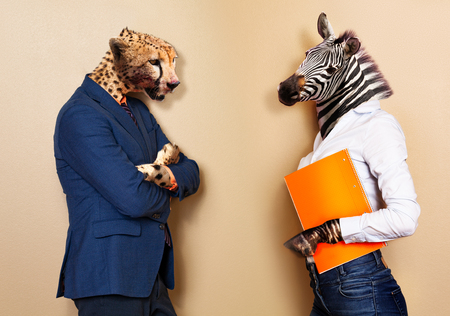 Boss and worker allegory with cheetah versus zebra Stock fotó