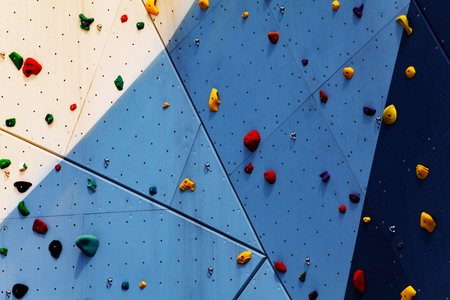 Close-up of climbing exercise wall with grips Banco de Imagens