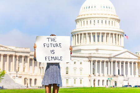 Protester holding feminist banner future is female Imagens - 119380710