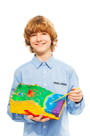 Boy pointing to the water at surface relief model