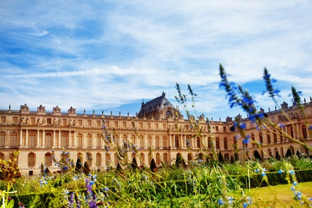 Versailles Palace through flowering park in France