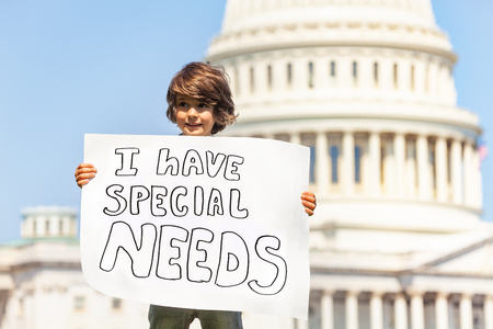 Protester boy holding sign I have special needs