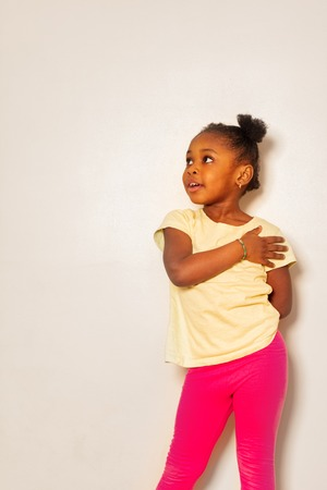 Little girl express herself with hand on shoulder