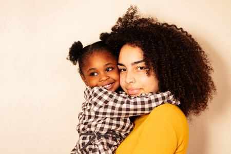 Close portrait of woman with little black girl