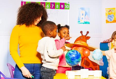 Group of kids in kindergarten play learn planet