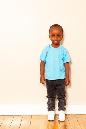 Full height portrait of little black boy smiling