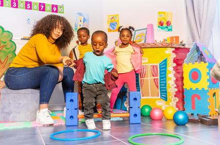 Early development games in kindergarten kids jump Banco de Imagens