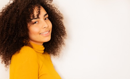 Young woman with beautiful smile and curly hair