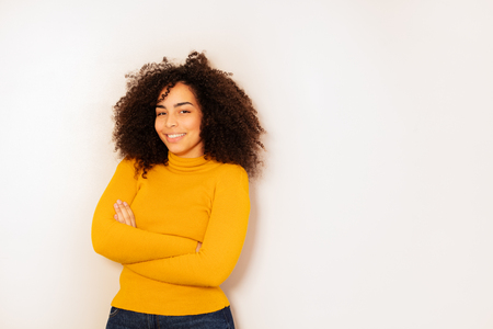 Happy young student age black girl with curly hair
