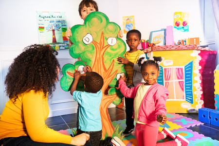 Kids learn alphabet by putting letters on tree