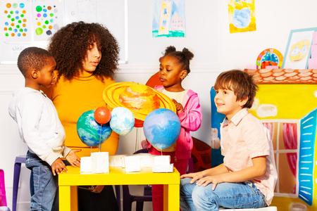 Kids group learn planets in kindergarten class