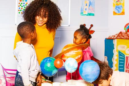 Group of kids in nursery school play learn planet 写真素材