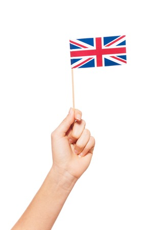 Small paper flag of Great Britain in womans hand