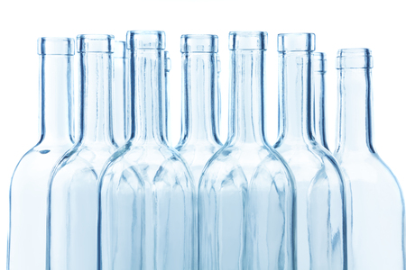 Clear glass wine bottles necks on white Foto de archivo - 120595347
