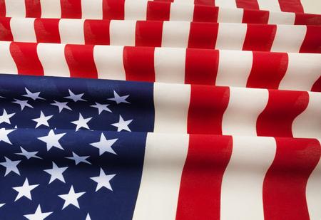 Textile pleated American flag laying on flatness