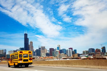 School bus on road over Chicago city Illinois, USA Фото со стока