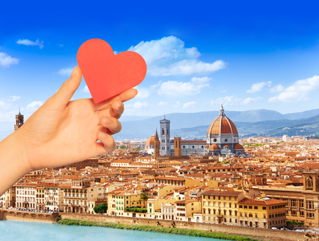 Hand hold red heart over Florence and Saint Mary