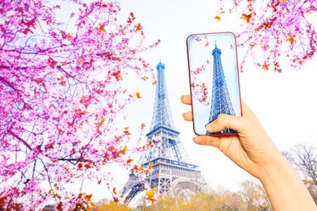Tourist take image of Paris Eifel tower at spring 写真素材