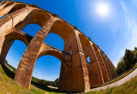 Low angle view of Chaumont viaduct railway bridge against blue sky, France Stock Photo