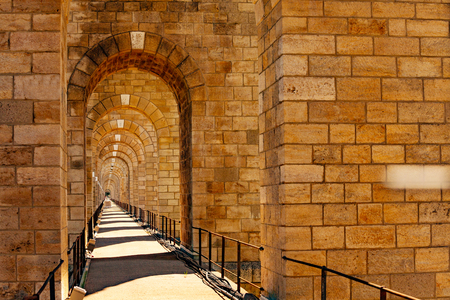 Perspective of stone arched abutments and sidewalk of Chaumont viaduct in France Archivio Fotografico - 123428946