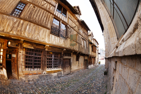 Narrow cobblestone paved street with old houses