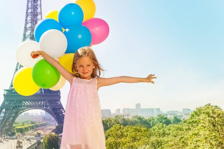 Cute little girl with colorful balloons in Paris Zdjęcie Seryjne