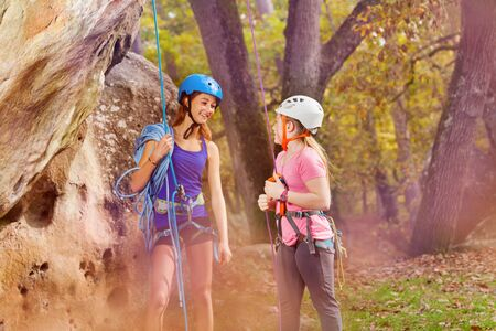 Rock climbing trainer and girl in special outfit