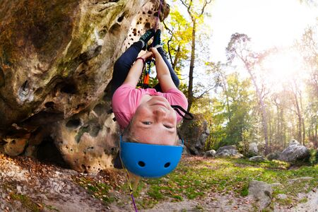 Girl having fun during rock climbing training Stock Photo