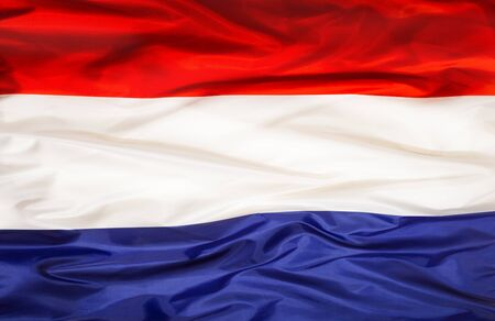 Niederländische Nationalflagge mit wehendem Stoff Standard-Bild