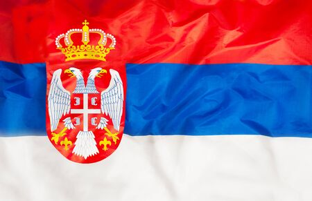 Serbia national flag with waving fabric