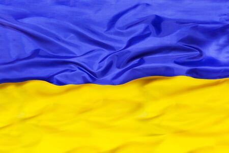Ukraine national flag with waving fabric 写真素材