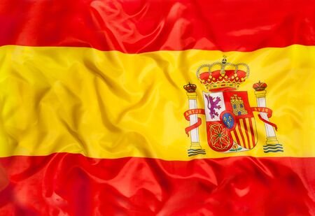 Spain national flag with waving fabric Stock Photo
