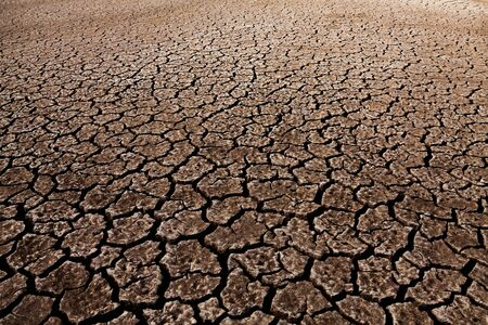 Cracked soil ground earth texture background Stock Photo