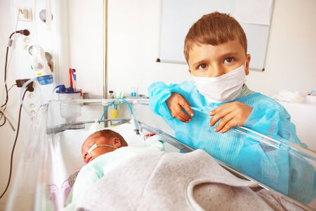 Little boy with premature infant brother, ICU