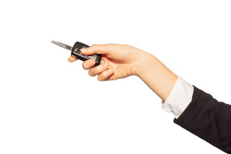 Womans hand holding alarm key fob of the car