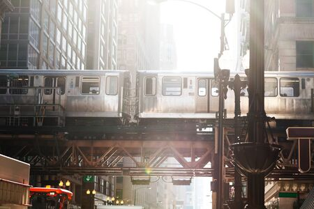 City metro train going above street in Chicago Imagens