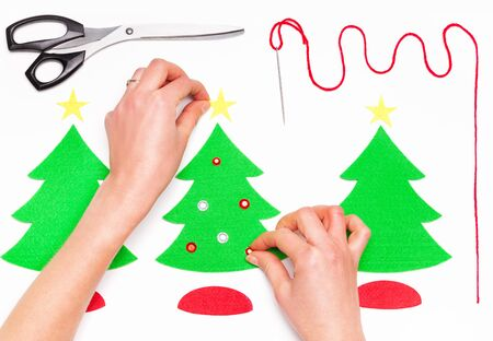 Female hands making Christmas greeting cards on white Stock Photo