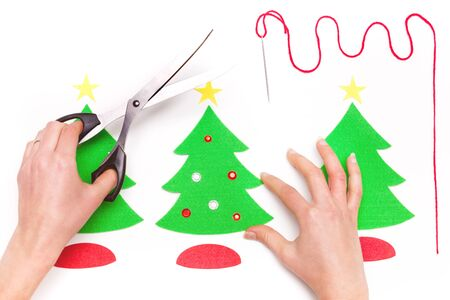 Woman using scissors and making Christmas cards Stock Photo