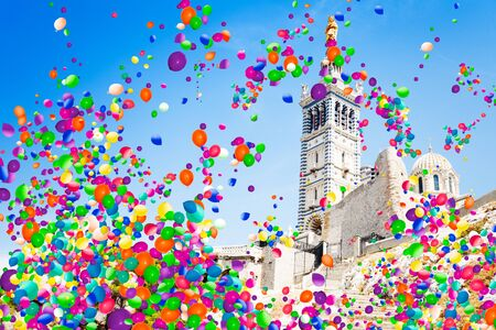 Basilica Notre-Dame de Marseille and balloons fly Stock Photo