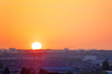 Sunset over urban area in France Paris suburbs