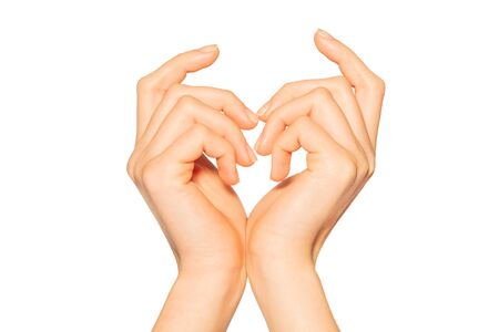 Pair of female hands making heart sign Imagens