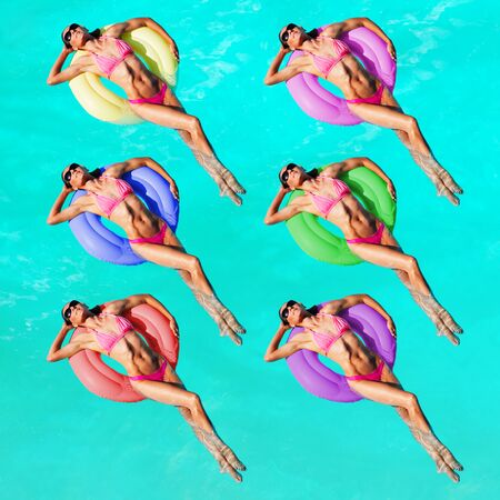 Women with different color buoys swim in the pool Stock Photo