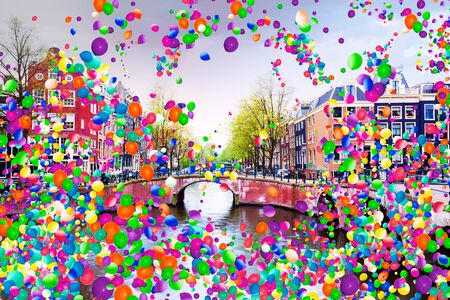 Amsterdam canal Netherlands with air balloons fly
